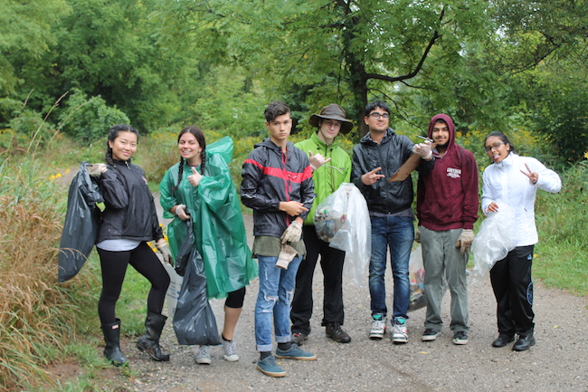 Frontline members taking part in the Great Canadian Shoreline Cleanup in the rain (Photo credit ©Credit Valley Conservation)