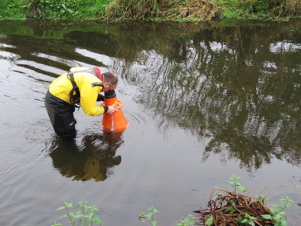 The Author using a bathyscope to look for submerged refuges for eels (Photo credit ©Peter Walker)
